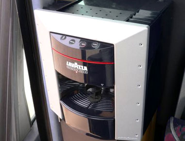 Coffee machine and fridge for beverages, available to passengers.